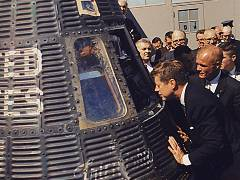 picture of Kennedy near the space capsule
